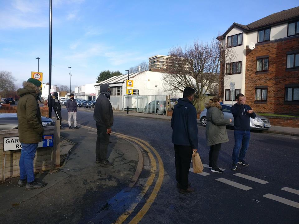 <p>The volunteers are turning cars away to help avoid fines</p> (Shakeel Yousaf)