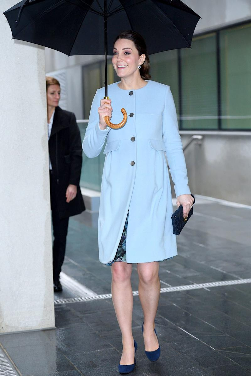 January 24: In a piercingly vibrant light blue coat, Kate looks positively jazzed to be walking into an event, rain be damned.