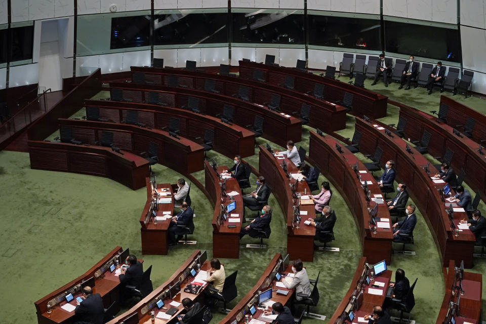 "Empty seats of pro-democracy legislators, top, are seen as Hong Kong Chief Executive Carrie Lam delivers her policies at chamber of the Legislative Council in Hong Kong, Wednesday, Nov. 25, 2020. Lam said Wednesday that the city's new national security law has been ""remarkably effective in restoring stability"" after months of political unrest, and that bringing normalcy back to the political system is an urgent priority. (AP Photo/Kin Cheung)"