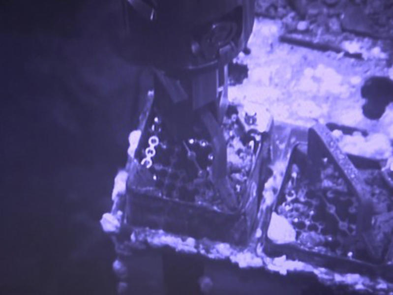 This image released by Tokyo Electric Power Co. (TEPCO) shows an operation to remove fuel from a cooling pool at Unit 3 of the Fukushima nuclear plant in Okuma town, Fukushima prefecture, northeastern Japan, Monday, April 15, 2019. The operator TEPCO of the tsunami-wrecked Fukushima nuclear plant began removing fuel from the cooling pool at one of three reactors that melted down in the 2011 disaster, a milestone in the decades-long process to decommission the plant. (Tokyo Electric Power Co. via AP)