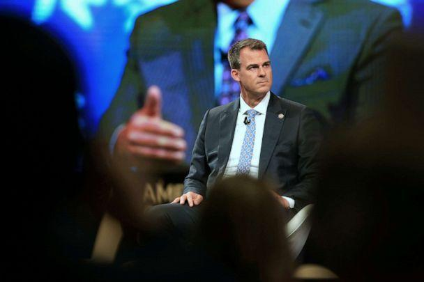PHOTO: Kevin Stitt, governor of Oklahoma, listens during the Conservative Political Action Conference (CPAC) in Dallas, July 10, 2021. (Dylan Hollingsworth/Bloomberg via Getty Images)