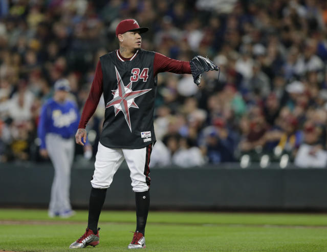 """Seattle Mariners starting pitcher Felix Hernandez waits for a new ball after giving up a home run against the Kansas City Royals during a baseball game, Saturday, June 30, 2018, in Seattle. The special uniforms are for a """"Turn Ahead the Clock"""" night. (AP Photo/John Froschauer)"""