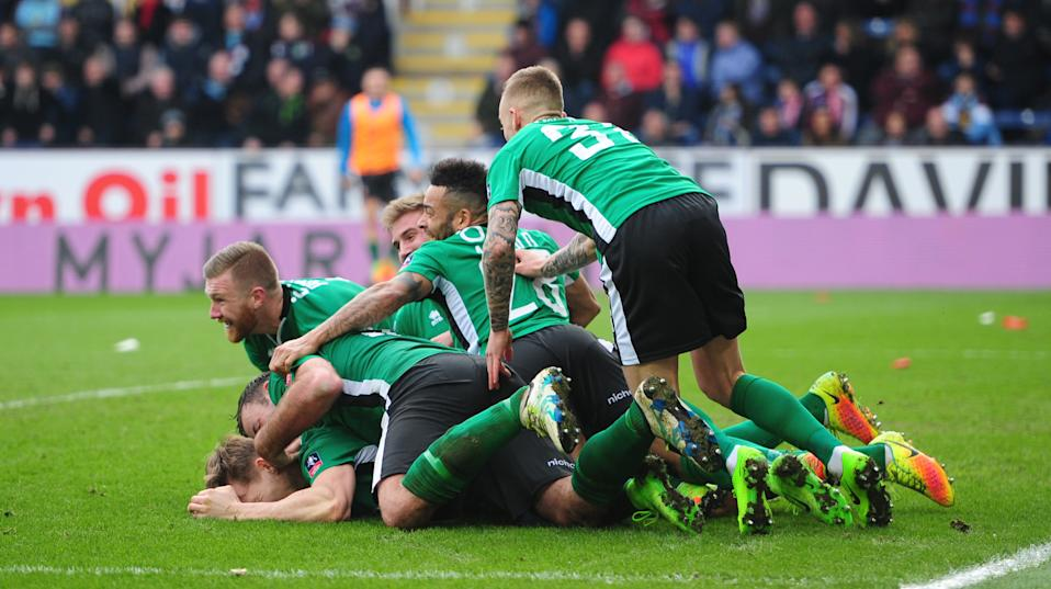 Lincoln City's Sean Raggett celebrates scoring the opening goal with team-mates during The FA Cup Fifth Round match between Burnley and Lincoln City. (Photo by Chris Vaughan - CameraSport via Getty Images)