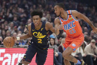 Cleveland Cavaliers' Collin Sexton (2) drives past Oklahoma City Thunder's Terrance Ferguson (23) in the first half of an NBA basketball game, Saturday, Jan. 4, 2020, in Cleveland. (AP Photo/Tony Dejak)
