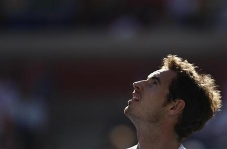 Murray of Britain reacts after a missed point against Wawrinka of Switzerland at the U.S. Open tennis championships in New York