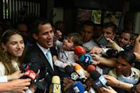 Guaido is seen holding his daughter Miranda, alongside his wife Fabiana Rosales, last month in Caracas