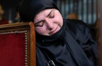 A relative of one of the victims of Beirut port explosion, reacts during a ceremony in Beirut