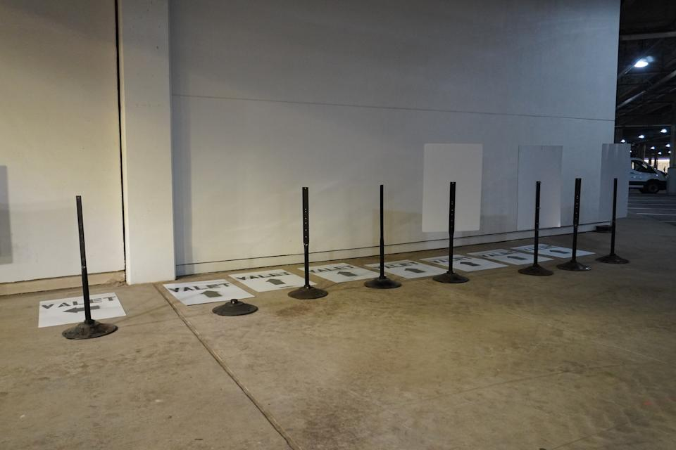 Freshly spray painted valet parking signs were drying as of Saturday morning.