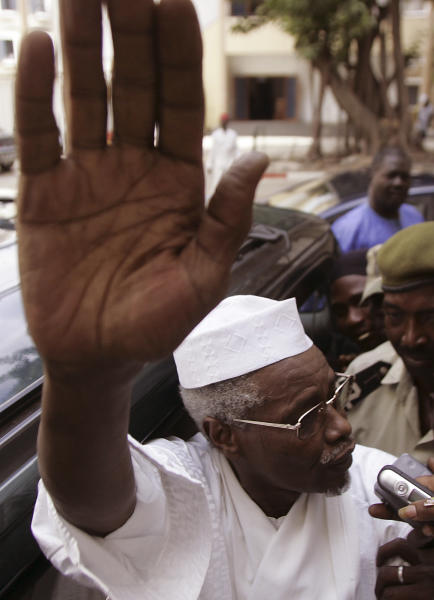 """FILE In this Nov. 25, 2005 file photo, former Chad dictator Hissene Habre gestures as he leaves the court in Dakar, Senegal. For more than 20 years, former Chadian dictator Hissene Habre lived a life of luxurious exile in Senegal, taking a second wife and watching """"Seinfeld"""" shows. But 3,000 miles east of here, a truth commission and rights workers in Chad were documenting widespread abuses during Habre's rule, including disappearances, torture and prison cells so cramped that inmates often died for lack of air. On Tuesday, July 2, 2013, judges at a special court in Dakar formally charged Habre with crimes against humanity, war crimes and torture.(AP Photo/Schalk van Zuydam, File)"""