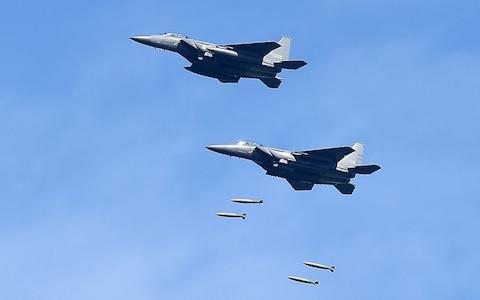 In this handout image provide by South Korean Defense Ministry, South Korea's F-15K fighter jets drop bombs during a training at the Taebaek Pilsung Firing Range - Credit: South Korean Defense Ministry via Getty Images