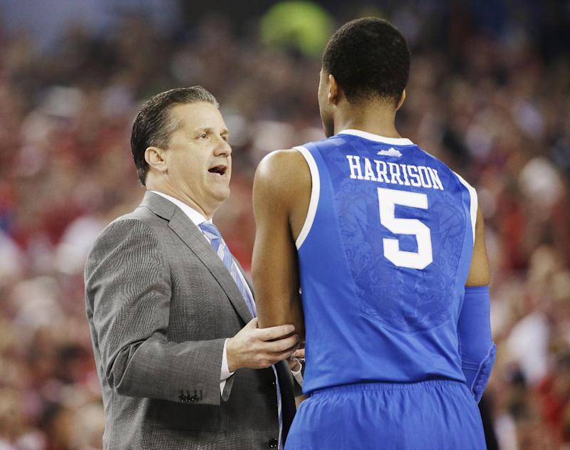 Kentucky Head Coach John Calipari Talks With Guard Andrew Harrison 5 During The First