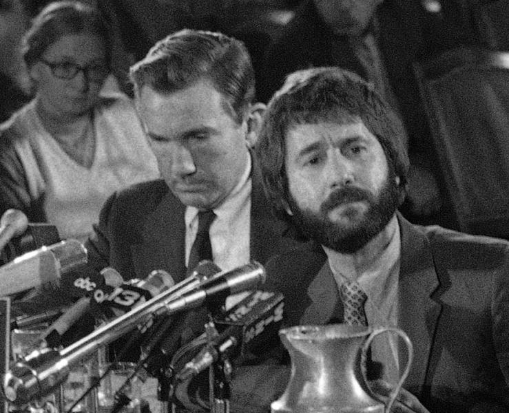 In this Dec. 13, 1971 file photo, New York City Detective Frank Serpico, right, sits beside his attorney, Ramsey Clark, in New York, during the Knapp Commission hearings on police corruption. Things haven't changed much since Serpico broke the NYPD's code of silence more than 40 years ago. Police officers are still encouraged to turn a blind eye to wrongdoing within their ranks and never question authority, or else face harassment by peers and punishment by superiors. (AP Photo/Jim Wells, File)