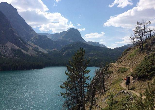 In this Aug. 30, 2016 photo, Mike Eckel hikes above a lake along the Beaten Path, a 26-mile hiking trail that crosses through Montana's Absaroka-Beartooth Wilderness. (Ben Yeomans via AP)