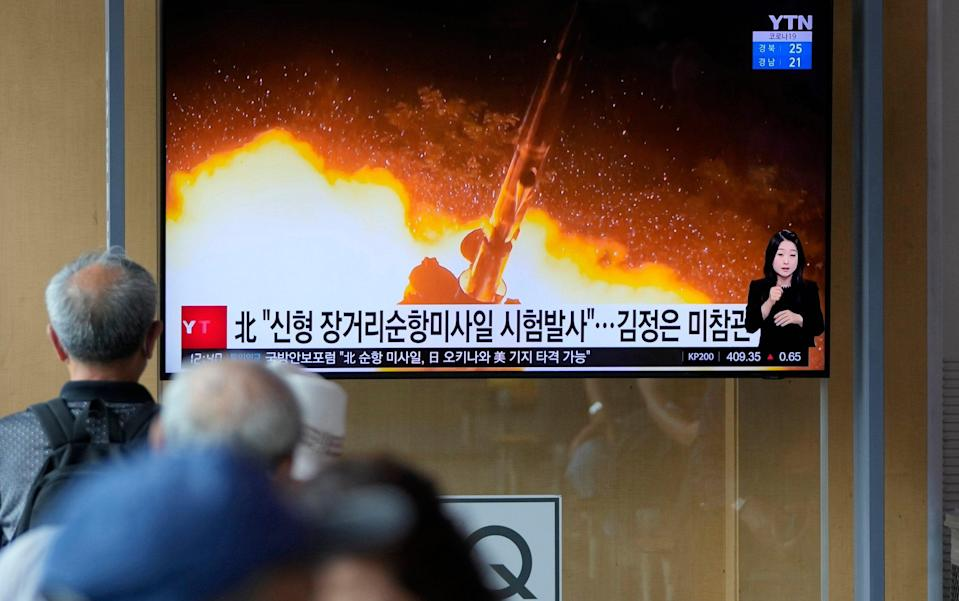South Koreans watched North Korea's cruise missile test on Sunday - AP