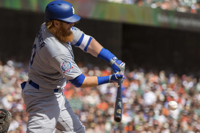 Los Angeles Dodgers Justin Turner (10) hits an RBI double against the San Francisco Giants in the first inning of a baseball game in San Francisco, Sunday, Sept. 30, 2018. (AP Photo/John Hefti)