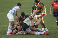 Jasper Wiese of South Africa is tackled during the second Rugby Championship match between Argentina and South Africa at the Nelson Mandela Bay Stadium, Gqebeha, South Africa, Saturday, Aug. 21, 2021. (AP Photo/Halden Krog(