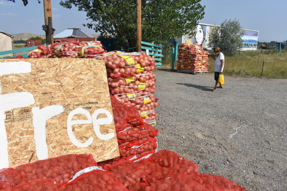 Sacks of onions and potatoes are given away by the non-profit organization Center Pole at the Crow Indian Reservation north of Garryowen, Mont. on Wednesday, Aug. 26, 2020. (AP Photo/Matthew Brown)