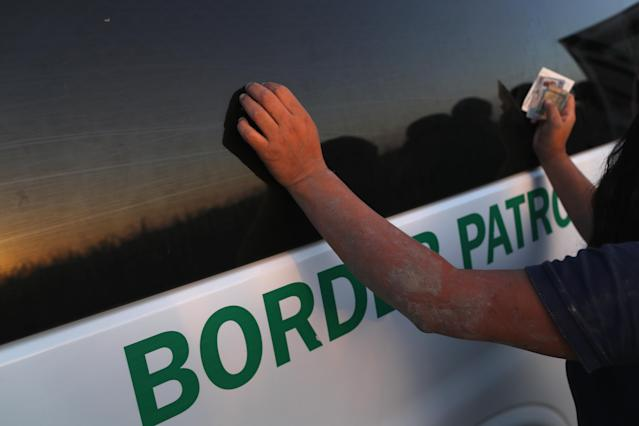 <p>An undocumented immigrant is bodysearched by a U.S. Border Patrol agent after being caught hiding in a sugarcane field near the U.S.-Mexico Border on June 12, 2018 near Mission, Texas. (Photo: John Moore/Getty Images) </p>