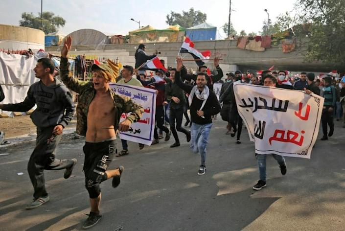 Iraqi supporters of the Iran-trained Hashed al-Shaabi paramilitary force join protesters in Baghdad's Tahrir Square in what is widely seen as an act of intimidation (AFP Photo/AHMAD AL-RUBAYE)