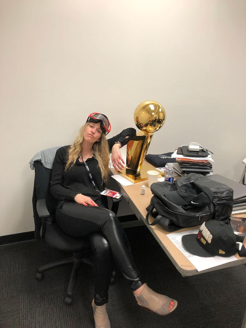 Toronto Raptors Shelby Weaver poses with Larry O'Brien trophy.