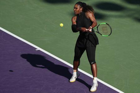 Mar 21, 2018; Key Biscayne, FL, USA; Serena Williams of the United States hits a backhand against Naomi Osaka of Japan (not pictured) on day two of the Miami Open at Tennis Center at Crandon Park. Osaka won 6-3, 6-2. Geoff Burke-USA TODAY Sports