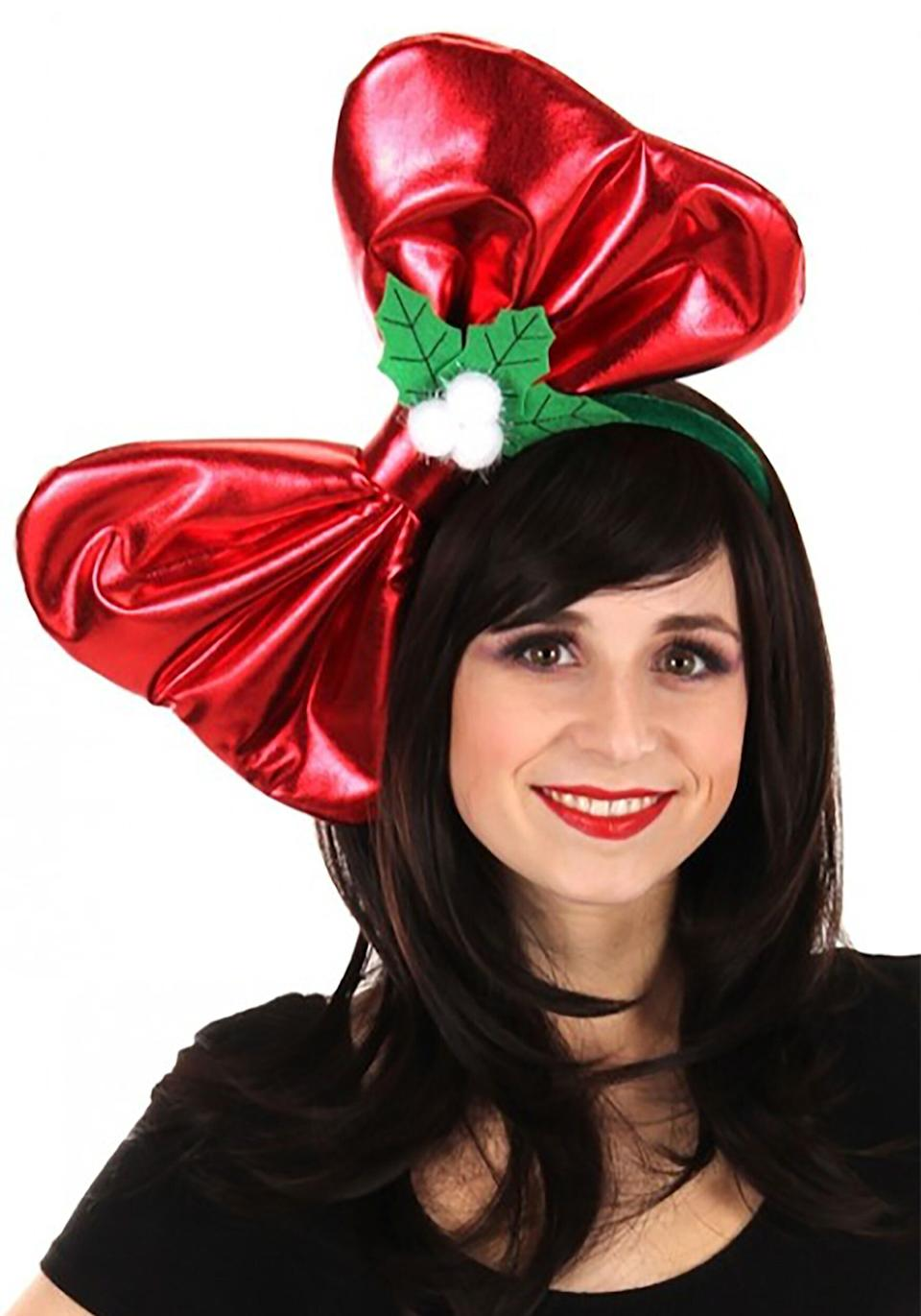 """""""Wow! That's a<a href=""""https://www.halloweencostumes.com/giant-christmas-bow-headband.html"""" target=""""_blank"""" rel=""""noopener noreferrer""""> really big bow</a> on your head.""""<br />""""Thank you!""""<br />""""I mean, it's really a large bow.""""<br />""""Yes, yes it is.""""<br />""""So, is there anything else interesting about you about besides this really large bow on your head?""""<br />""""Not really!"""""""