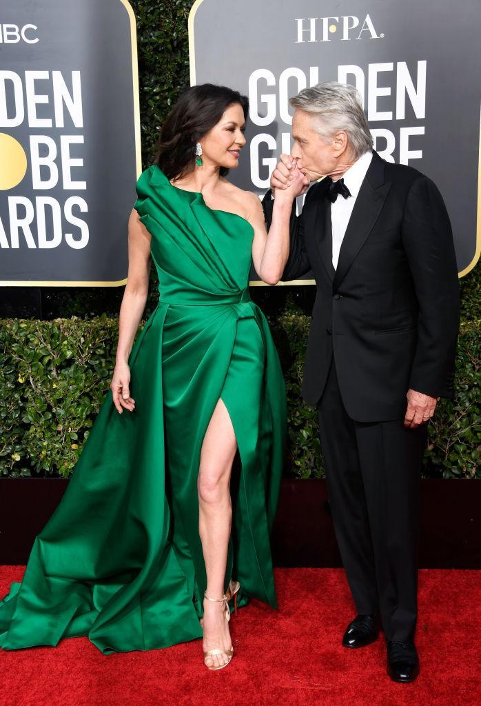 Catherine Zeta-Jones wowed at the 2019 Golden Globes in a satin green frock with her usual thigh-high split. (Getty Images)
