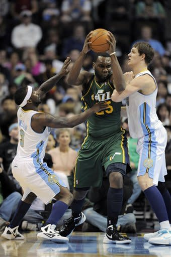 Utah Jazz center Al Jefferson (25) is pressured by Denver Nuggets guard Ty Lawson (3) and center Timofey Mozgov (25) from Russia during the first quarter of an NBA basketball game, Sunday, Jan. 15, 2012, in Denver. (AP Photo/Jack Dempsey)