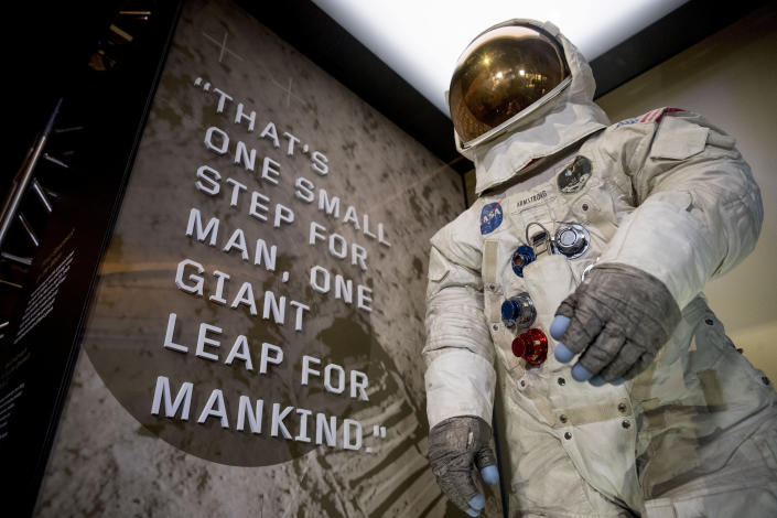 Neil Armstrong's Apollo 11 spacesuit is unveiled at the Smithsonian's National Air and Space Museum on the National Mall in Washington, Tuesday, July 16, 2019. (AP Photo/Andrew Harnik)