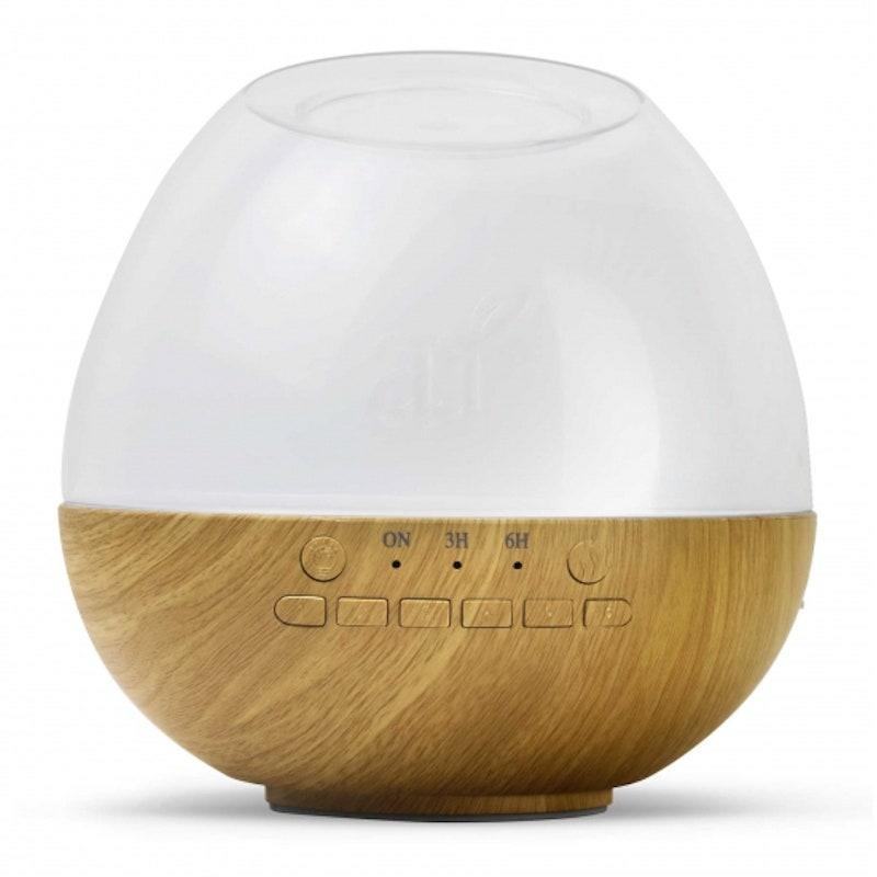 """<p>If you're looking for a multitasking option, you've found it. Art Naturals' Deluxe Sleep 'n Slumber Oil Diffuser is made from wood-grained casing for a classic, warm look, but don't let its simple exterior fool you. It also comes with a color-changing LED light and six soothing nature sounds to help lull you into a refreshing sleep.</p> <p><strong>$29</strong> (<a href=""""https://artnaturals.com/sound-diffuser.html"""" rel=""""nofollow noopener"""" target=""""_blank"""" data-ylk=""""slk:Shop Now"""" class=""""link rapid-noclick-resp"""">Shop Now</a>)</p>"""