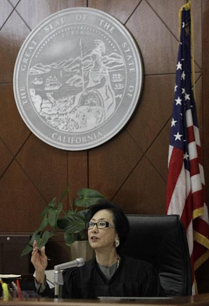 Judge Lillian Sing gestures to a defendant on the bench of the Community Court Tuesday, Sept. 18, 2012, in San Francisco. While it's been difficult for researchers to determine cost savings by the courts, new studies suggest the courts are helping stem crime. An evaluation of Washington, D.C.'s community court by the Westat research firm found this summer that defendants who successfully completed diversion programs from 2007 to 2009 were half as likely to reoffend as similar defendants in a traditional court. (AP Photo/Ben Margot)