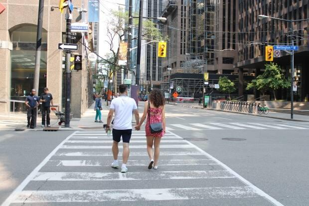 More than 500 signals have been installed in Toronto that give pedestrians a five-second head-start to cross before vehicles are permitted to enter the intersection.   (Yasmine Ghania/CBC - image credit)