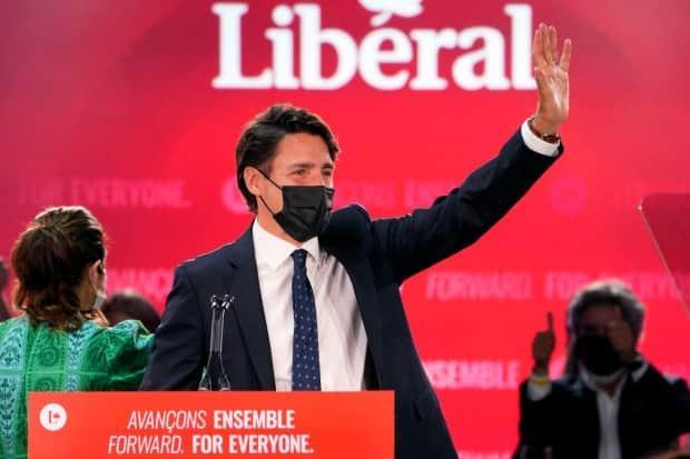 Prime Minister Justin Trudeau greets supporters prior to his victory speech at Liberal Party campaign headquarters in Montreal, early Tuesday morning.  (Paul Chiasson/The Canadian Press - image credit)