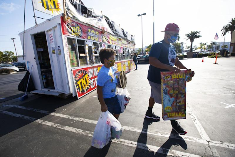 Jaden Veal, 7, and his father, James Veal, of Hawthorne purchase fireworks.