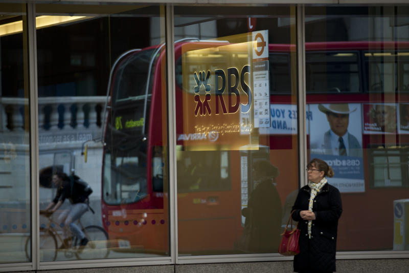 A RBS, Royal Bank of Scotland, illuminated sign and logo are seen through a window of their offices as a bus is reflected driving past in London, Thursday, June 13, 2013. Bailed-out U.K. lender Royal Bank of Scotland said Wednesday that Stephen Hester will step down as chief executive later this year — a move that creates some uncertainty as the bank prepares to return to the private sector. The board of the bank, which is 81 percent owned by the taxpayer after it was rescued by the U.K. government in 2008, said Hester was unable to make an open-ended commitment to lead the bank back into the private sector after having already served five years. The search for a successor will begin immediately. (AP Photo/Matt Dunham)