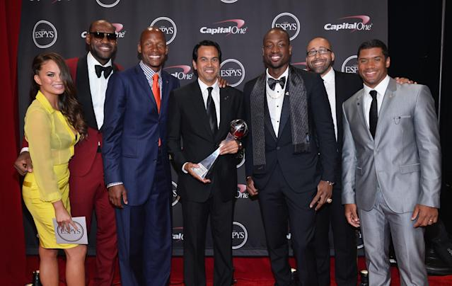 LOS ANGELES, CA - JULY 17: (L-R) Model Chrissy Teigen, NBA players LeBron James and Ray Allen, Miami Heat head coach Erik Spoelstra with the Best Game award, NBA player Dwyane Wade, Miami Heat assistant coach David Fizdale, and NFL player Russell Wilson pose backstage at The 2013 ESPY Awards at Nokia Theatre L.A. Live on July 17, 2013 in Los Angeles, California. (Photo by Alberto E. Rodriguez/Getty Images for ESPY)