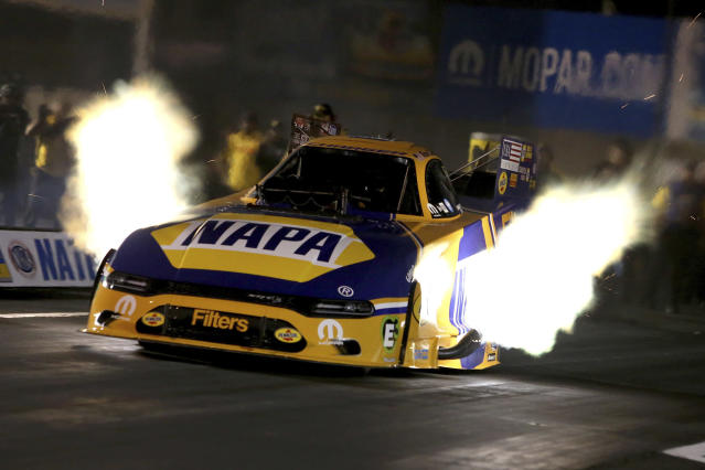 In this photo provided by the NHRA, Ron Capps secures the provisional No. 1 qualifying position in Funny Car, Friday, Sept. 13, 2019, at the annual Mopar Express Lane NHRA Nationals in Mohnton, Pa. (Bob Szelag/NHRA via AP)