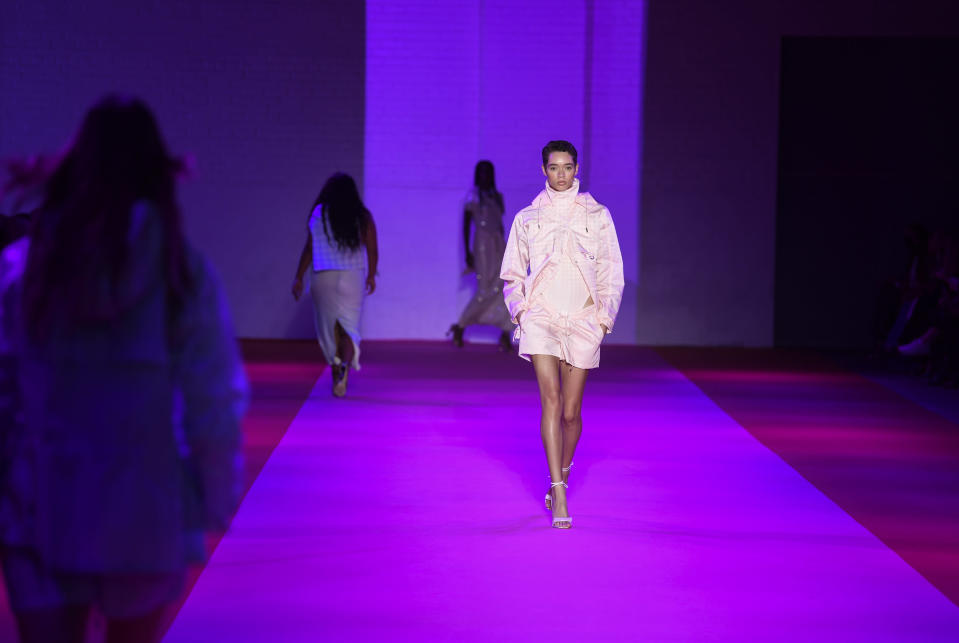 A model walks the runway at the Brandon Maxwell spring/summer 2022 fashion show in the Brooklyn borough of New York during Fashion Week on Friday, Sept. 10, 2021. (Photo by Evan Agostini/Invision/AP)