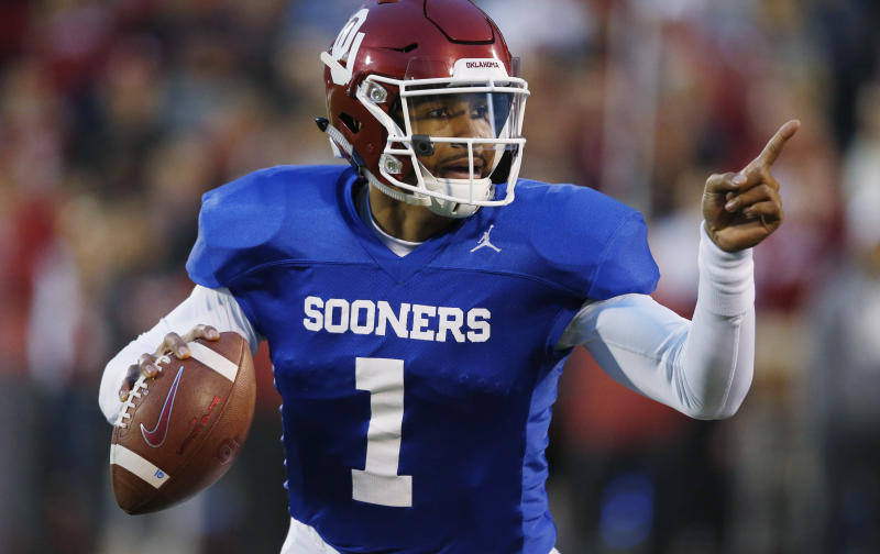 FILE - In this Friday, April 12, 2019 file photo, Oklahoma quarterback Jalen Hurts gestures during the NCAA college football team's spring game in Norman, Okla. Oklahoma quarterback Jalen Hurts is cramming as he prepares for his only year with the Sooners. Before transferring from Alabama, he played in three national title games. (AP Photo/Sue Ogrocki, File)