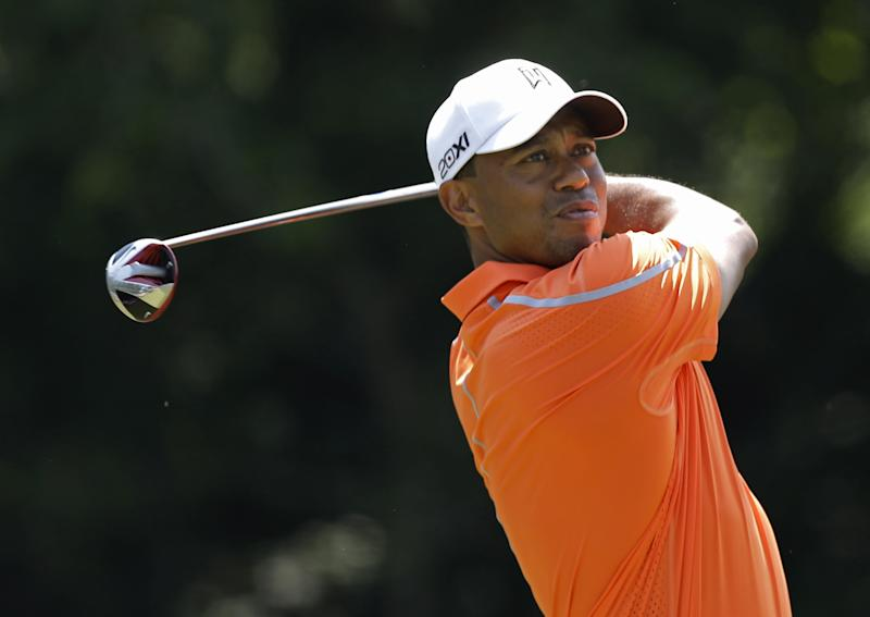 Tiger Woods hits from the seventh tee during the first round of The Players championship golf tournament at TPC Sawgrass, Thursday, May 9, 2013, in Ponte Vedra Beach, Fla. (AP Photo/John Raoux)