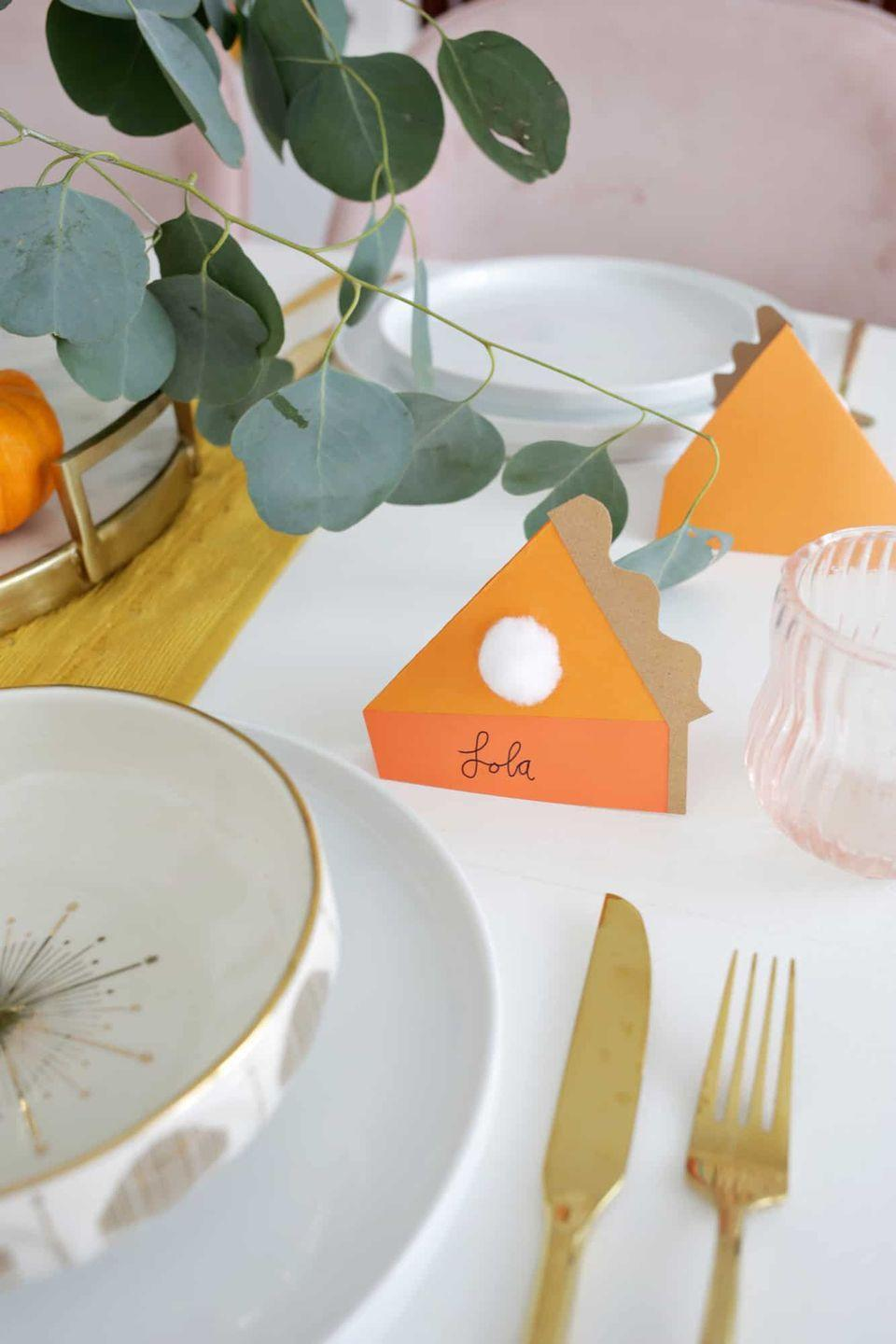 "<p>If you have a big group gathering, these pumpkin pie name cards will let them know exactly where to sit...and will get them ready for dessert. All it takes is construction paper, glue, and cotton balls, according to <a href=""https://abeautifulmess.com/easy-pumpkin-pie-place-cards/"" rel=""nofollow noopener"" target=""_blank"" data-ylk=""slk:A Beautiful Mess"" class=""link rapid-noclick-resp"">A Beautiful Mess</a>.</p><p><a class=""link rapid-noclick-resp"" href=""https://personalgiftsetc.com/collections/craft-supplies/products/cotton-pom-pom"" rel=""nofollow noopener"" target=""_blank"" data-ylk=""slk:BUY NOW"">BUY NOW</a> <em><strong>Cotton pom pom, $0.35</strong></em></p>"