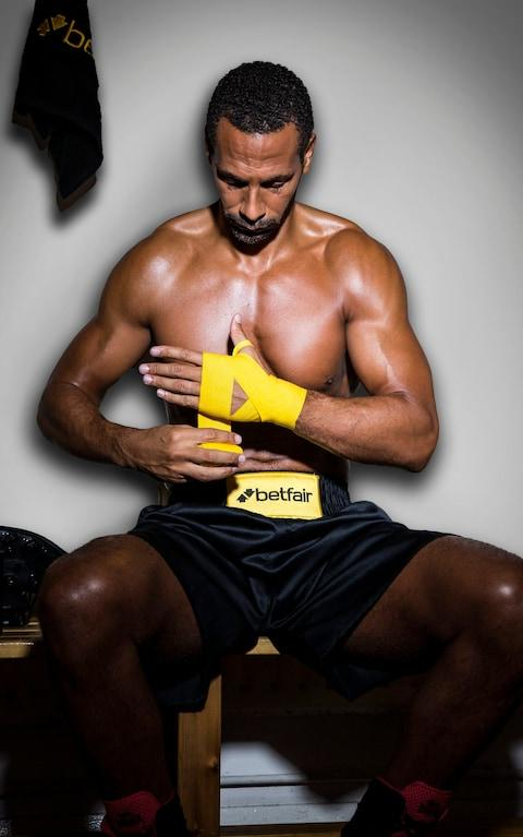 """Rio Ferdinand will aim to become a boxing champion after confirming he is taking up the sport. As exclusively revealed by Telegraph Sport on Monday, the former Manchester United and England star will attempt to enter the ring for the first time at the age of 38. Announcing the move as part of a project entitled 'Defender to Contender', Ferdinand denied the move was a publicity stunt. The BBC and BT Sport pundit plans to fight a succession of bouts in the next year, with the ultimate aim of competing for a title. Ferdinand, whose switch to boxing is being backed by the bookmaker Betfair and will be chronicled in a documentary, will be trained by former WBC super-middleweight champion turned Great Britain trainer Richie Woodhall and his own personal trainer, former rugby union centre Mel Deane. A number of current and ex-boxers will also be employed by Ferdinand to help him prepare for specific fights and hone specific skills. Ferdinand said: """"I've always been one to set goals and keep improving. Since retiring from football, I've still been training intensely and I'm in better physical condition than ever. I get no bigger buzz than when I'm training and this is an opportunity to prove myself all over again. """"This definitely isn't a stunt. I'll be undertaking an intensive boxing training regime over the next year under the expert guidance of Richie Woodhall and Mel Deane. We'll take things step by step and build up slowly but the end goal is to compete for a title belt. @anthony_joshua dug deep & showed it's great having talent but when all said & done grit & determination in the trenches is what gets you through real testing times. Salute the champ! #klitschko showed real class in defeat too...something I wish I could of had a bit more of if I'm really honest! A post shared by Rio Ferdinand (@rioferdy5) on Apr 30, 2017 at 1:06am PDT """"I'll firstly need to be granted a boxing licence to compete professionally. From there if successful, the plan would be to build up slo"""