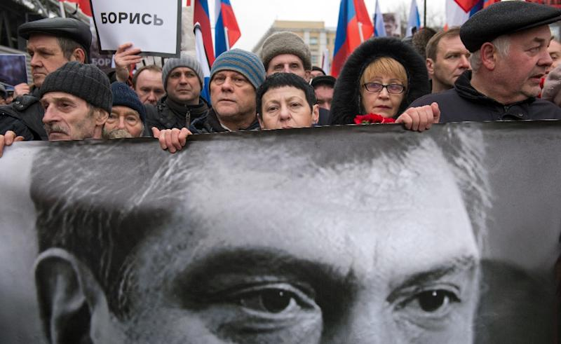 Russia's opposition supporters carry a banner bearing a portrait of Kremlin critic Boris Nemtsov during a march in central Moscow on March 1, 2015 (AFP Photo/Alexander Utkin)