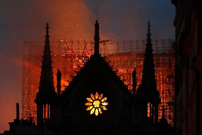 Flames and smoke rise from Notre Dame cathedral as it burns in Paris, Monday, April 15, 2019. (Photo: Thibault Camus/AP)