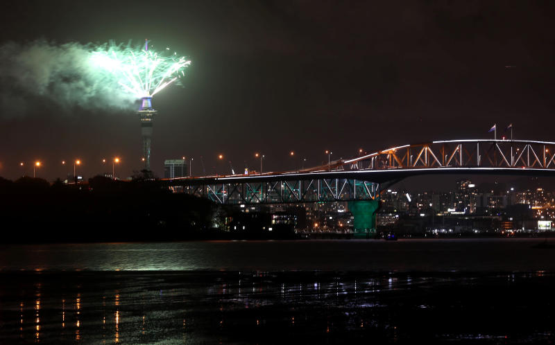 Fireworks explode from Auckland's Sky Tower as the New Year is welcomed in Auckland, New Zealand