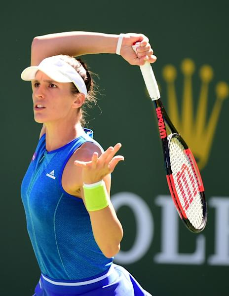 Andrea Petkovic hits a forehand during her match against Angelique Kerber at Indian Wells Tennis Garden