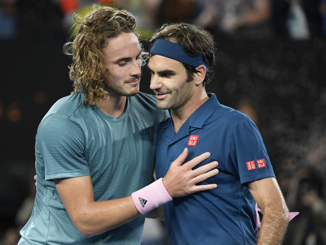 <p> Greece's Stefanos Tsitsipas, left, is congratulated by Switzerland's Roger Federer after winning their fourth round match at the Australian Open tennis championships in Melbourne, Australia, Sunday, Jan. 20, 2019. (AP Photo/Andy Brownbill) </p>