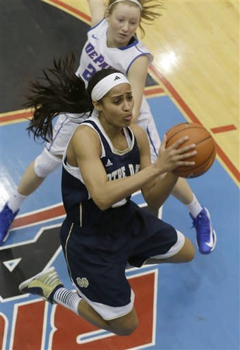 Notre Dame guard Skylar Diggins (4) drives to the basket past DePaul guard Megan Rogowski (21) during the second half of an NCAA women's college basketball game in Chicago on Sunday, Feb. 24, 2013 .Notre Dame won 84-56. (AP Photo/Nam Y. Huh)