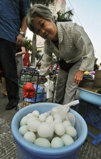 An elderly Chinese woman shops for eggs in 2008 despite nationwide fears of melamine contamination, at a market in Xiamen. Decades of industrial development greased by corruption has produced unprecedented levels of pollution and an epidemic of toxic foodstuffs, made and marketed by ruthless entrepreneurs