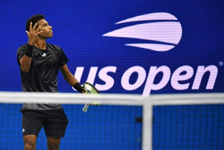 Canada's Felix Auger-Aliassime reached his first Slam semi-final when 55th-ranked Spanish 18-year-old Carlos Alcaraz retired trailing 6-3, 3-1 with a leg injury (AFP/Ed JONES)